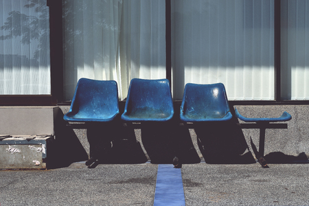 Old blue plastic chairs for service recipients or for passengers Banque d'images - 106639852