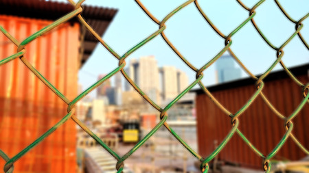 Chain link fence at construction site Stock Photo