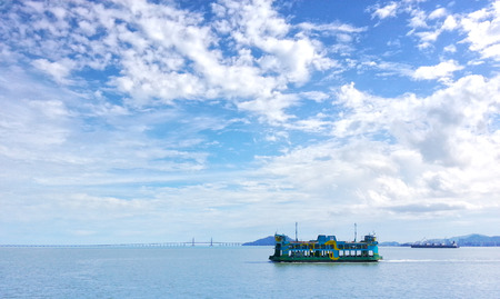 Penang Ferry service with Penang Bridge at the background