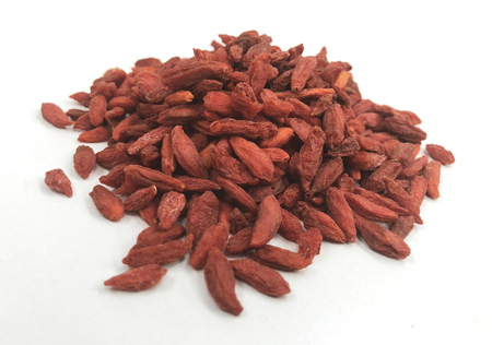 Composition of dried wolfberries isolated on white background ( goji berries) Stock Photo