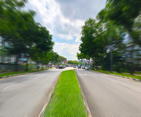 Grassy road divider with motion blur zoom in effect Stock Photo