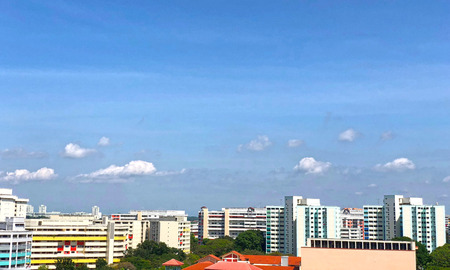 Panorama view of Singapore housing estate under cloudy blue sky Stock Photo