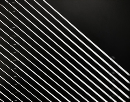 Light reflects against black wall, forming white lines. Abstract concept Reklamní fotografie
