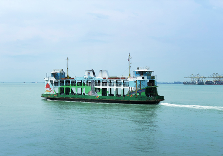 colorful Penang Ferry service with Georgetown at the background Redakční