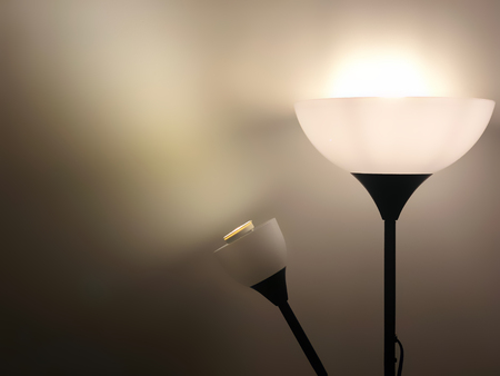 Lamp with brown light beam shine to the wall. Spot light concept. Stockfoto