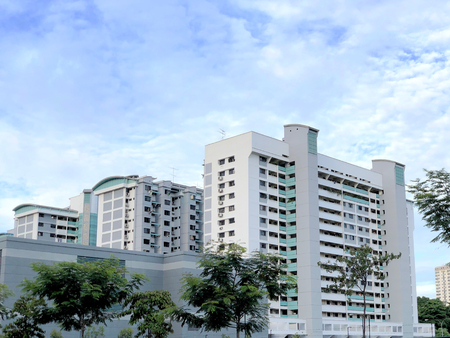 Singapore housing blocks (HDB) under cloudy blue sky Editorial