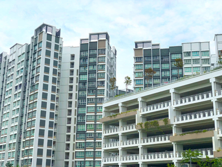 Modern Looking residential apartment (HDB) with multi-storey carpark in Singapore under cloudy blue sky