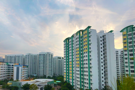 Modern Looking residential apartment (HDB) in Singapore under cloudy blue sky