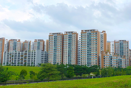Modern Looking residential apartment (HDB) in Singapore with green environment under cloudy blue sky