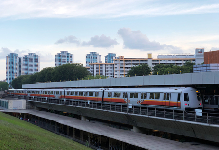 Singapore mass rapid train (MRT) travels on the track approaching station