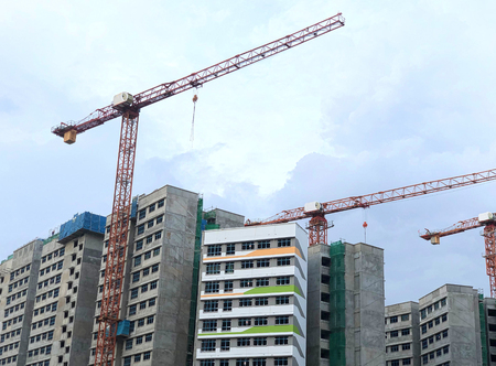 Blocks of Buildings under construction with cranes
