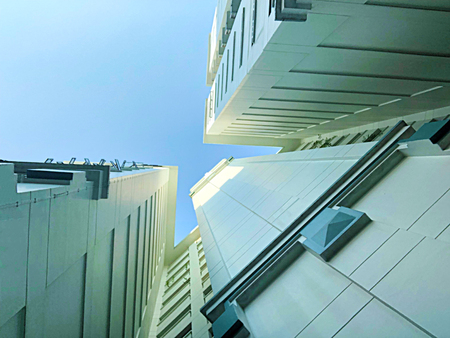 worms eye view of residential apartments architecture that resembles triangle