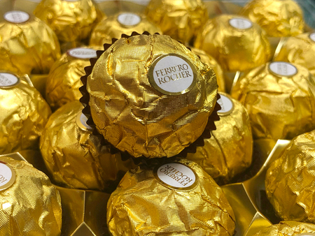 SINGAPORE - 25 DECEMBER 2018: Focused view of Ferrero Rocher chocolate, which are associated with Christmas and New Year as a gift.