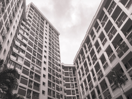 Grayscale image of residential apartment in Singapore under cloudy sky Editorial