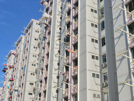 Back view of Singapore HDB flat, showing laundry hanging on the pole for drying