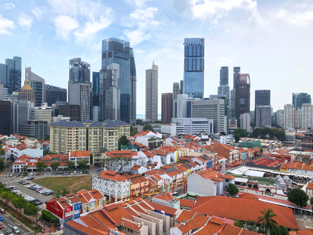 Singapore, 17 February 2019 - Singapore financial district and colonial conserved shophouses as seen from Chinatown, an ethnic neighborhood featuring distinctly Chinese cultural elements Editorial
