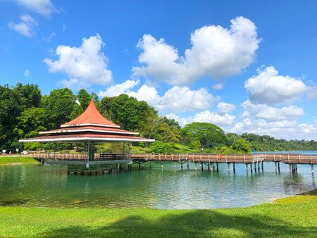 Scenic view of a shelter in the centre of the lake under cloudy blue sky