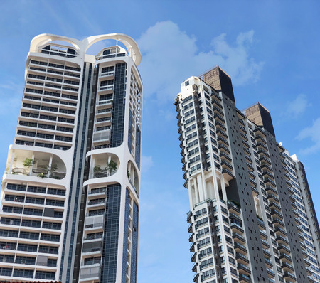 Singapore luxury apartments under cloudy blue sky