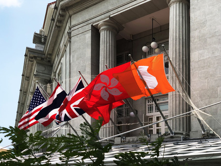 Singapore: 9 March 2019 - Countries flag decorated by The Fullerton Hotel in Singapore, a five-star luxury hotel and gazetted in December 2015 as a National Monument Editorial