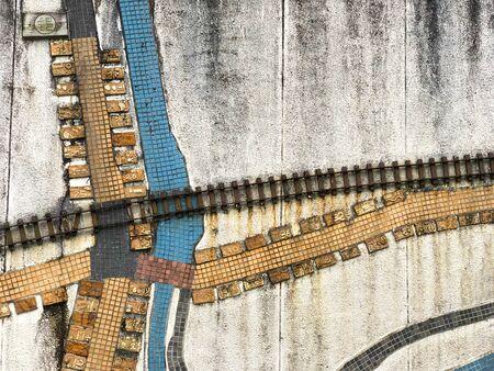 Unique wall art comprises tiles arrangement. Wallpaper and abstract.