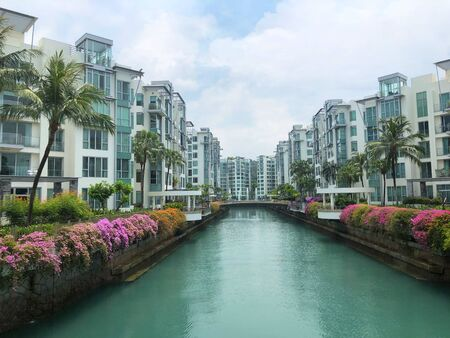 Modern Looking luxury residential apartment/ condominium on both sides of river in Singapore