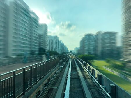 LRT Track surrounded by residential apartments  with motion blur