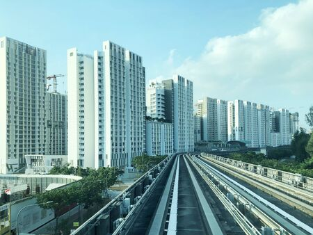 LRT Track passing through dense residential apartments area