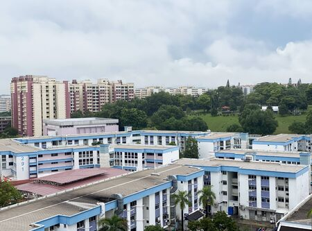Aerial View of Singapore's HDB under cloudy blue sky