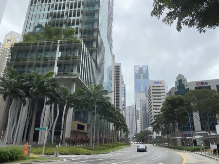 SINGAPORE:07 Dec 2019 - Empty street/ road with little traffic at Singapore CBD area with dense buildings