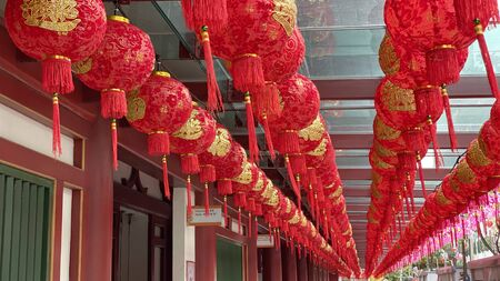 Chinese Lanterns Decor hanging at the temple - Chinese text on the lanterns means luck and prosperity