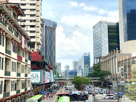 Singapore: 20 October 2019 - Singapore Chinatown Street view with heavy traffic from overhead pedestrian bridges Stock Photo