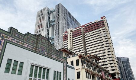 Singapore modern housing residential blocks behind row of old shop house - fusion/ contrast concept Stock Photo