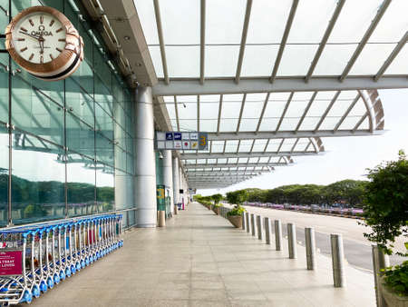 SINGAPORE,4 APRIL 2020: External entrance facade with taxi drop-off and pickup area of Terminal 2 at Changi Airport. It's empty due to COVID-19's travel ban.