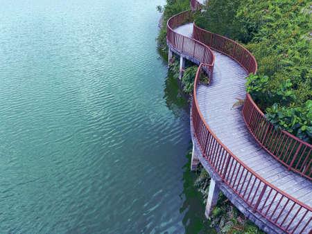 Singapore,27 June 2020: The Lorong Halus bridge,cursive design pedestrian bridge connecting Punggol town to Lorong Halus Wetland.