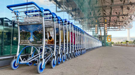 SINGAPORE, 4 APRIL 2020: Row of empty trolleys line up outside drop-off/pick-up point of Changi Airport Terminal 2.