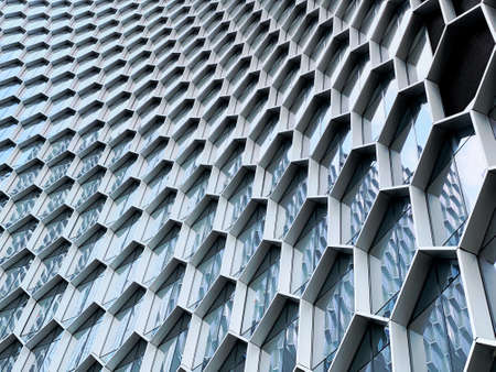 Singapore - Feb 15 2020: Abstract view of the beehives facade of the Duo Residences on Beach Road, a new iconic 49-storey residential tower in the heart of Bugis and the CBD of Singapore Editorial