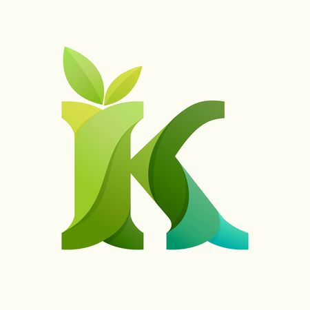 Swirling letter K logo with green leaves. Slab serif font can be used for eco, vegan, bio, raw, organic template.
