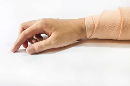 Right hand and wrist in thick bandages and cast after injury or surgery  photo