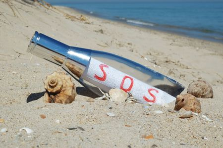 Message in a bottle with SOS signal Stock Photo - 4438512