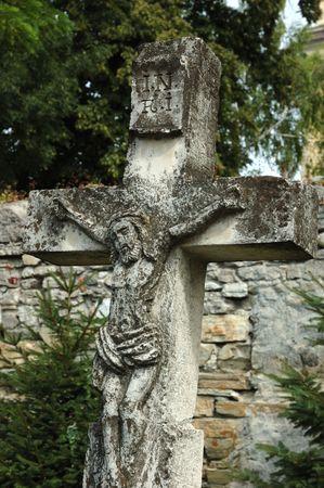 churchyard: Old catholic cross on churchyard Stock Photo