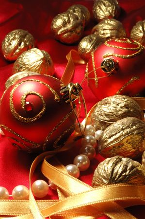 Red christmas balls and golden walnuts photo
