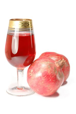 Glass of fresh juice and two pomegranates photo