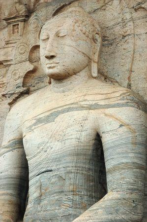 Sitting Buddha In ancient city of Polonnaruwa,ceylon photo
