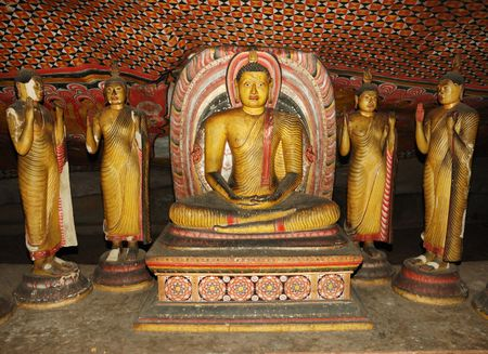 Buddha statues at Dambulla - buddhist cave temple complex in Sri Lanka,UNESCO world heritage photo