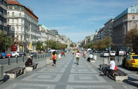 historical events: Prague,Czech Republic, August 12,2008 - Tourists are walking on Wenceslas Square .It is one of main city squares and the centre of the business and cultural communities in the New Town of Prague. Many historical events occurred there
