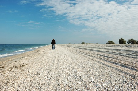uninhabited: Man walking on uninhabited island