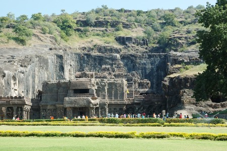 jainism: Ellora,India,December 15,2009 - big religious complex with buddhist, hindu and jain cave temples.People are visiting sacred place