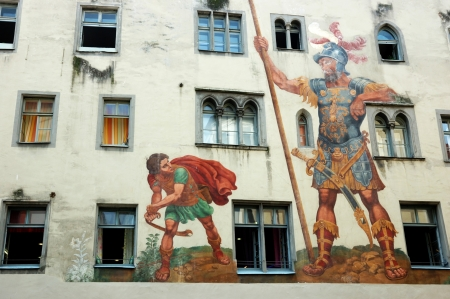 window graffiti: David and Goliath on the house wall ,Regensburg,unesco heritage