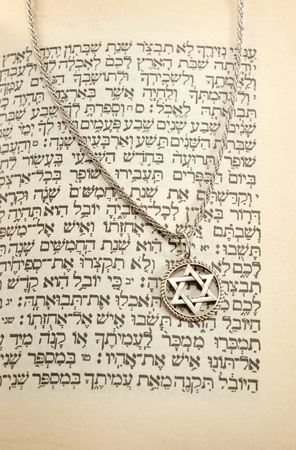 The Torah and siver chain with magen david photo