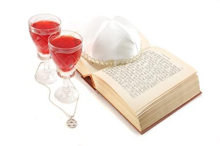 Jewish holiday still life with torah,wine glasses,david star and kippah photo